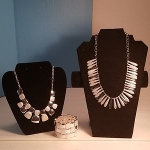 Two silver tone necklaces, one bracelet